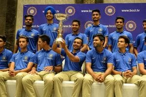 The Indian team pose with the ICCU-19 cricket World Cup trophy in Mumbai on Monday.