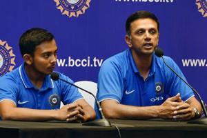 ICC Under-19 Cricket World Cup winning coach Rahul Dravid (right)and Indian U-19 cricket team captain Prithvi Shaw during a press meet after their arrival in Mumbai on Monday.