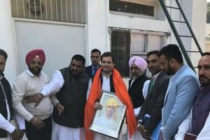 Congress president Rahul Gandhi meets party workers from across the country at AICC headquarters in New Delhi on Wednesday.