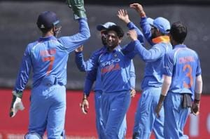 Kuldeep Yadav, centre, and teammates celebrate the wicket of Aiden Markram during the third ODI between South Africa and India inCape Town. Follow highlights of India vs South Africa, 3rd ODI in Cape Town here.