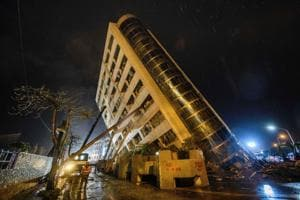 Rescuers scour tilting buildings after Taiwan quake kills seven,...