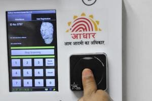 Employees mark their attendance through Aadhaar-based system in the Planning Commission.