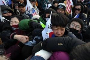 Winter Olympics: North Korea's arrival in Pyeongchang greeted with...