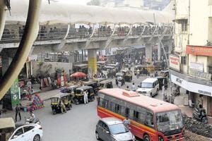 The area around Dombivli station is a maze with illegally parked vehicles and hawkers occupying pedestrian space.