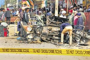Officials examining the car in which a bomb was placed in Maur on February 1 last year, a day after the blast near Congress leader Harminder Singh Jassi's election rally.