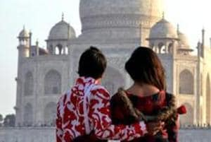 A couple near the historic Taj Mahal on the eve of Valentine