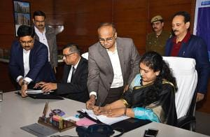 GDA vice-chairperson Ritu Maheshwari signs the MoU with the public sector undertaking of the Union power ministry on Friday.