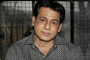 Gangster Abu Salem while being taken to jail after a Mumbai court sentenced him life imprisonment.