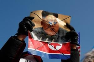 Winter Olympics: Anti-North Korea protesters burn flags before opening...
