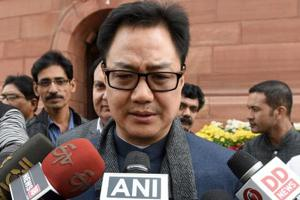 Home Affairs Kiren Rijiju speaks to reports outside Parliament in New Delhi.