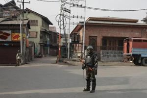 Paramilitary soldiers stand guard during restrictions in downtown area of Srinagar.