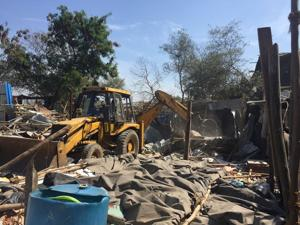 The district administration started a series of demolition drives at a 10-acre mangrove patch near Yari Road in Versova on Friday.
