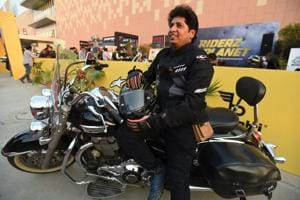 Biker Dinesh Gupta has been riding his Triumph cruiser to the motor show every day to make visitors aware of road safety.