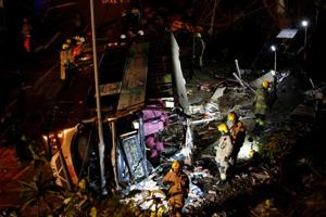 18 killed as double-decker bus topples over in Hong Kong