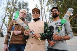 Professor Samrat Ghosh and his students show the prototype of 'smokeless smart crackers' in Mohali on Sunday.