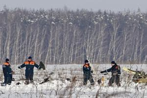 Photos: Investigators comb site after plane crash near Moscow kills 71