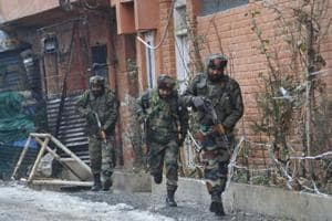 Indian Army personnel take position during an encounter with militants in Karan Nagar, Srinagar.