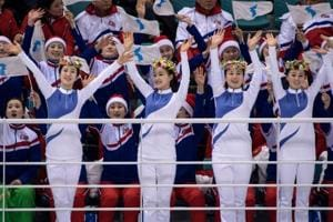 Life's a beach as North Korea cheerleaders mobbed by media at...