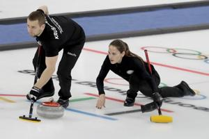 2018 Winter Olympics: Russian pair claims first mixed doubles curling...