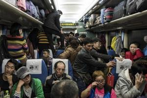 Photos: Millions of migrants leave Beijing for Lunar holidays with...