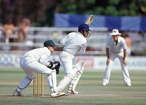 Sanjay Manjrekar batting for India during his innings of 104 runs in the inaugural test match between Zimbabwe and India at the Harare Sports Club, 21st October 1992. The Zimbabwe wicketkeeper is Andy Flower. The match ended in a draw.
