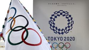 File image of the Olympic flag (left) and the logo of the Tokyo 2020.