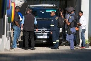 South African police arrest 2 in Gupta house raid amid...