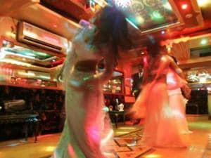 Police raid dance bar in Mumbai, find 16 young women crammed in a...