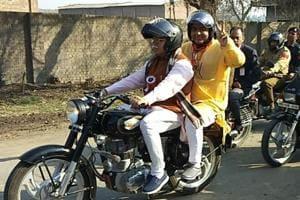 Haryana chief minister Manohar Lal Khattar riding a bike in Karnal on Thursday.