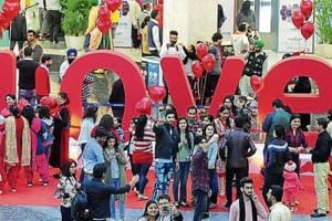 LOVE ALL AROUND: Elante Mall abuzz with activities as youngsters take selfies with the backdrop of 'Love' on Valentine's Day in Chandigarh on Wednesday.