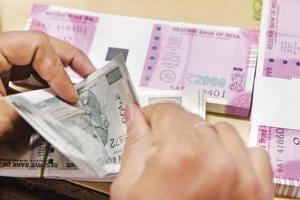 Rupee gains 14 paise to a 2-week high in opening trade