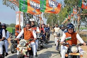 BJP national president Amit Shah riding pillion with Haryana BJP chief Subhash Barala and CM Manohar Lal Kattar (right) during the Yuva Hunkar Rally in Jind on Thursday.