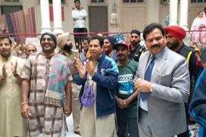 Hindu pilgrims from Pakistan celebrating their visa extension in Amritsar's Durgiana Temple on Friday.