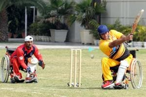 Players of UP Strikers (red) and Delhi Sultans (yellow) take part in the Indian Wheelchair Cricket League, organised by the Para Sports Foundation in Gurgaon, on Friday.