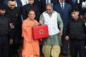 Uttar Pradesh chief minister Yogi Adityanath (left) and UP finance minister Rajesh Agarwal hold a briefcase containing State Budget for 2018-19 ahead of the presentation at Vidhan Sabha in Lucknow on Friday.