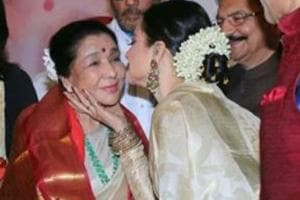 Rekha touches Asha Bhosle's feet at Yash Chopra award, leaves her...
