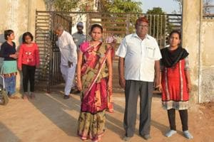 Shankarlal Verma with his two daughters at Gayatri Chetna Centre in Jalpali, Rajasthan.