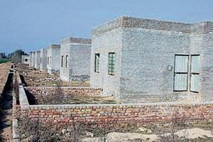 Two-room houses made for the poor by the HMEL, which runs the Bathinda refinery, in Kandu Khera village in Lambi segment represented by former CM Parkash Singh Badal; the houses lack finishing touches and are locked.