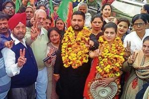 BJP candidate Kiran Bala with her supporters in Ludhiana on Friday.