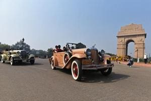 People drive around as part of a vintage car rally at India Gate on Saturday. Starting from India Gate, the cars reached Gurgaon, where they will be showcased till Sunday