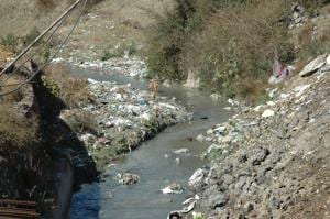 A rivulet in Uttarakhand's Pithoragarh that flows into the Kali River,  choked with untreated sewage.