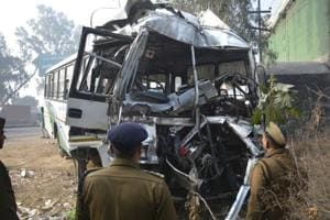 Policemen assess damage to the Rajasthan roadways bus from Jalore that met with an accident on the former NH-58 in Ghaziabad, on Sunday morning. There were 48 passengers, of whom 40 were injured; the bud driver died on the spot.