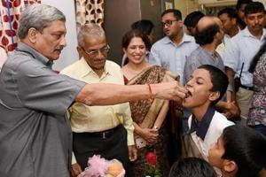 Goa chief minister Manohar Parrikar celebrates his 62nd birthday in Panaji on December 13, 2017.
