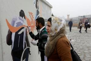 Art for change: Activists in Afghanistan paint walls with messages of...