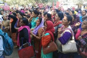 NHM workers protested outside the Civil Hospital in Gurgaon on Tuesday.