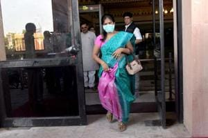 MLA Rani Silautia leaves the assembly wearing mask after giving sample for swine flu test on Wednesday.