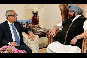 Chief minister Captain Amarinder Singh with Niti Aayog vice-chairman Rajiv Kumar during a meeting in Chandigarh on Thursday.