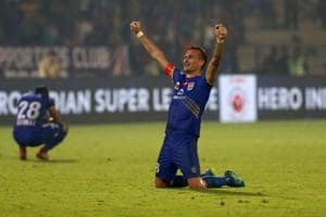 Mumbai City FC skipper Lucian Goian led from the front as he scored a...