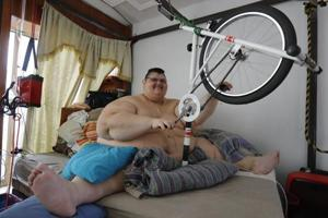 A large part of Juan Pedro Franco's day is devoted to his exercises. These include lifting weights, pulling resistance cords and pedalling his hand-cranked stationary bike.