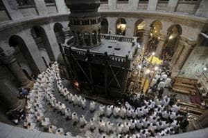 Jerusalem church leaders shut Christ's burial site in land, tax...
